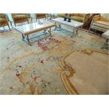 A sumptuous 100% pure new wool carpet 11.2m x 4.4m cream field with a floral central medallion and