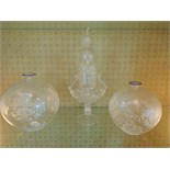 A fine blown etched glass candy jar with a pair of fine etched glass bowls