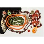 A SELECTION OF COSTUME JEWELLERY, to include a long orange bead necklace suspending a dragonfly