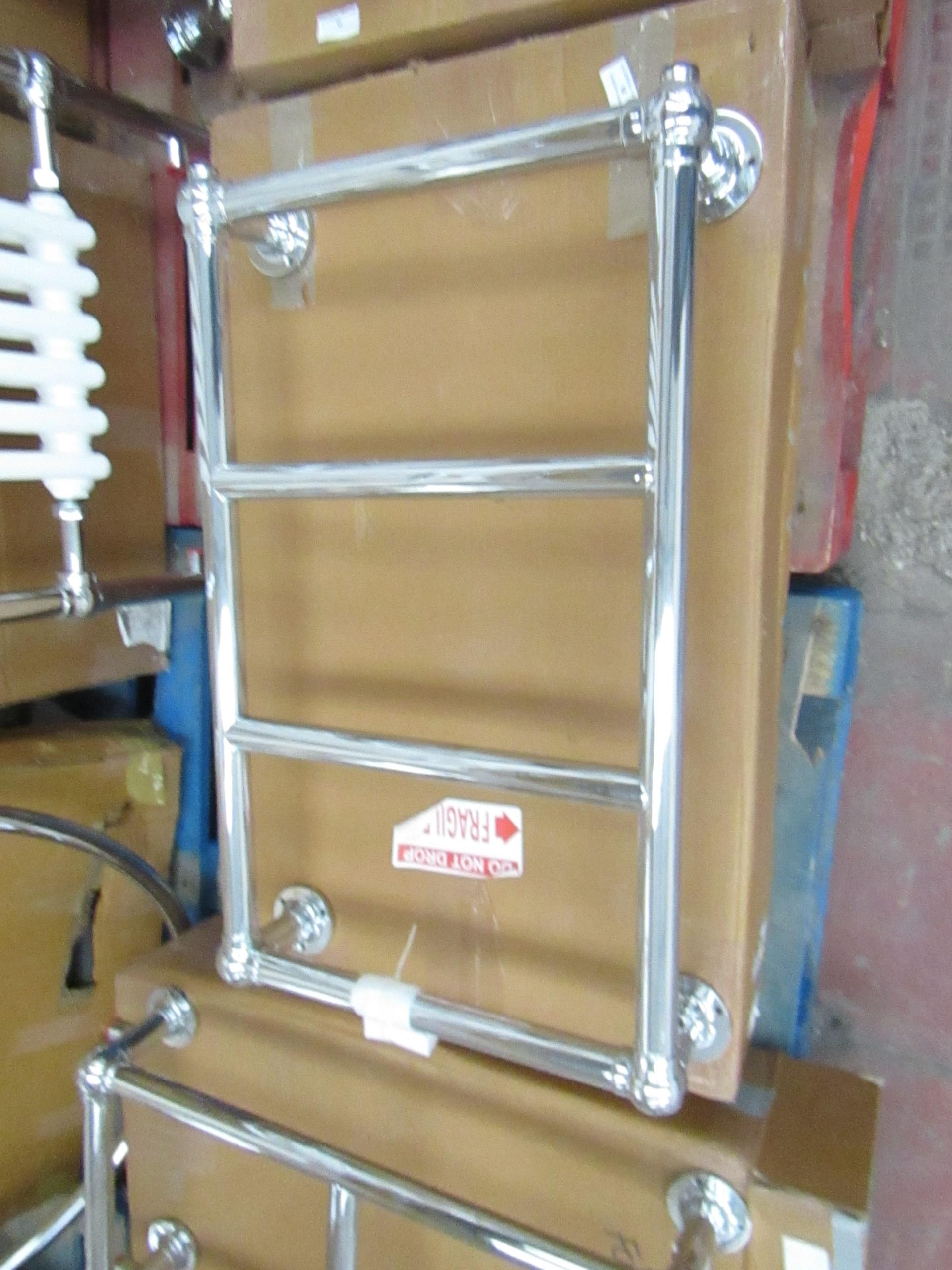 Chrome Astor wall mounter radiator, unchecked and boxed 72 x 44 x 14cm