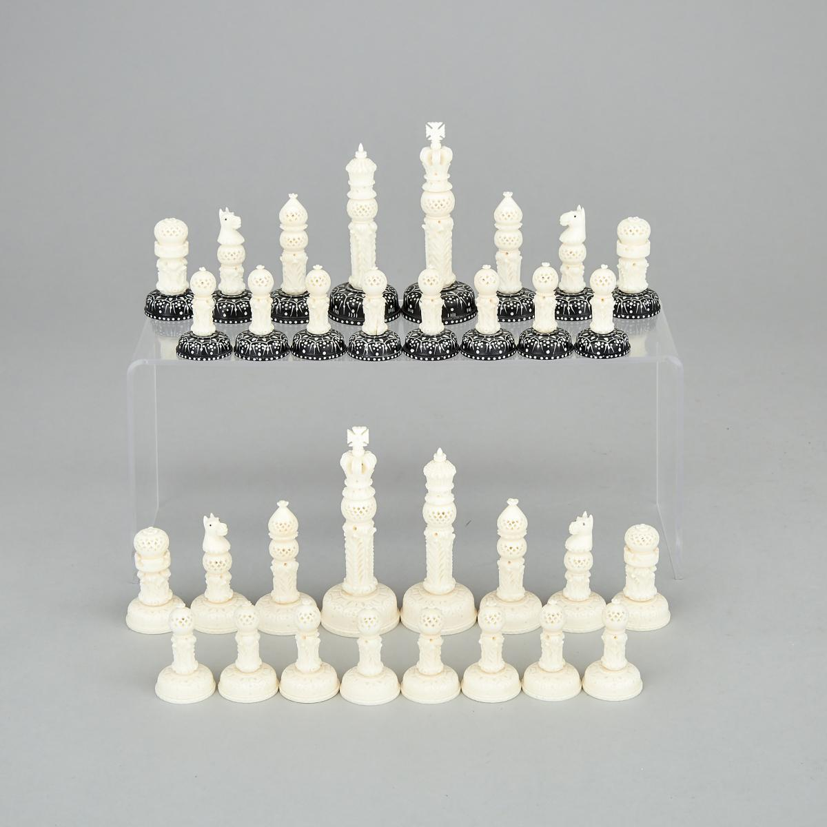 Lot 36 - Indian Ivory Pierce Carved Chess Set, early-mid 20th century, height 4 in — 10.2 cm