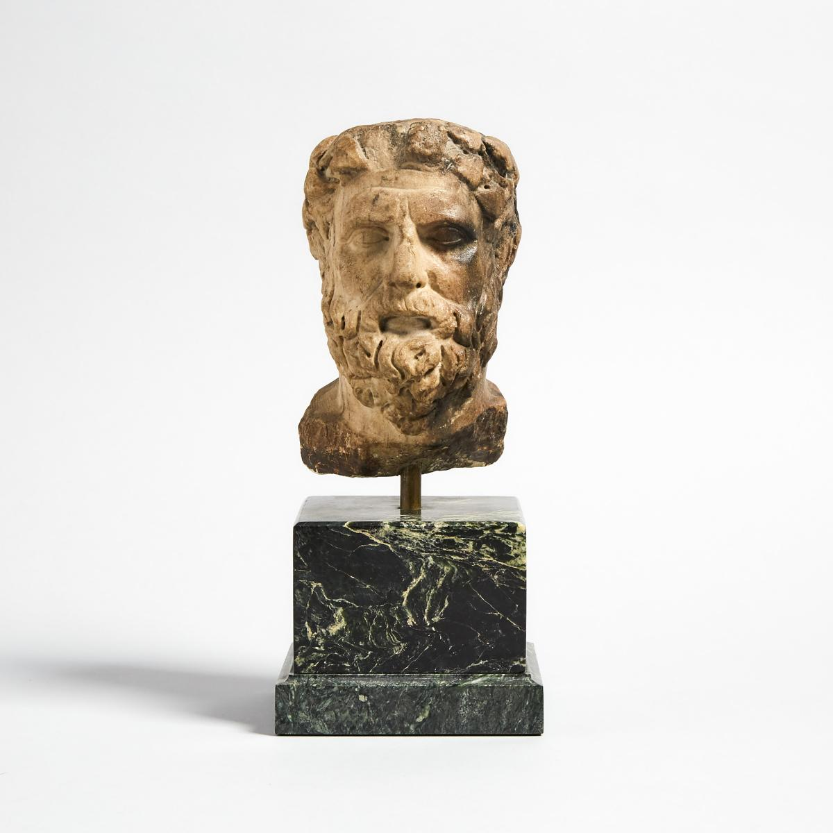 Roman Marble Head of Dionysus, 2nd century A.D., head height 6.25 in — 15.9 cm