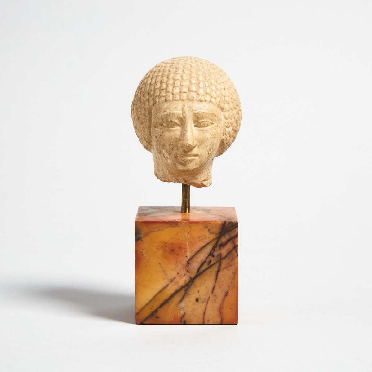 Egyptian Limestone Ka Statue Head of a Young Man, Old Kingdom, head height 3 in — 7.5 cm; 5.9 in — 1