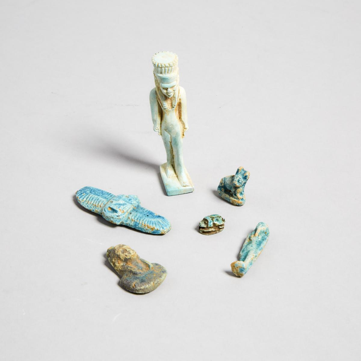 Six Egyptian Faience Amulets, Late Period, 3500-30 B.C., tallest height 3 in — 7.6 cm (5 Pieces)