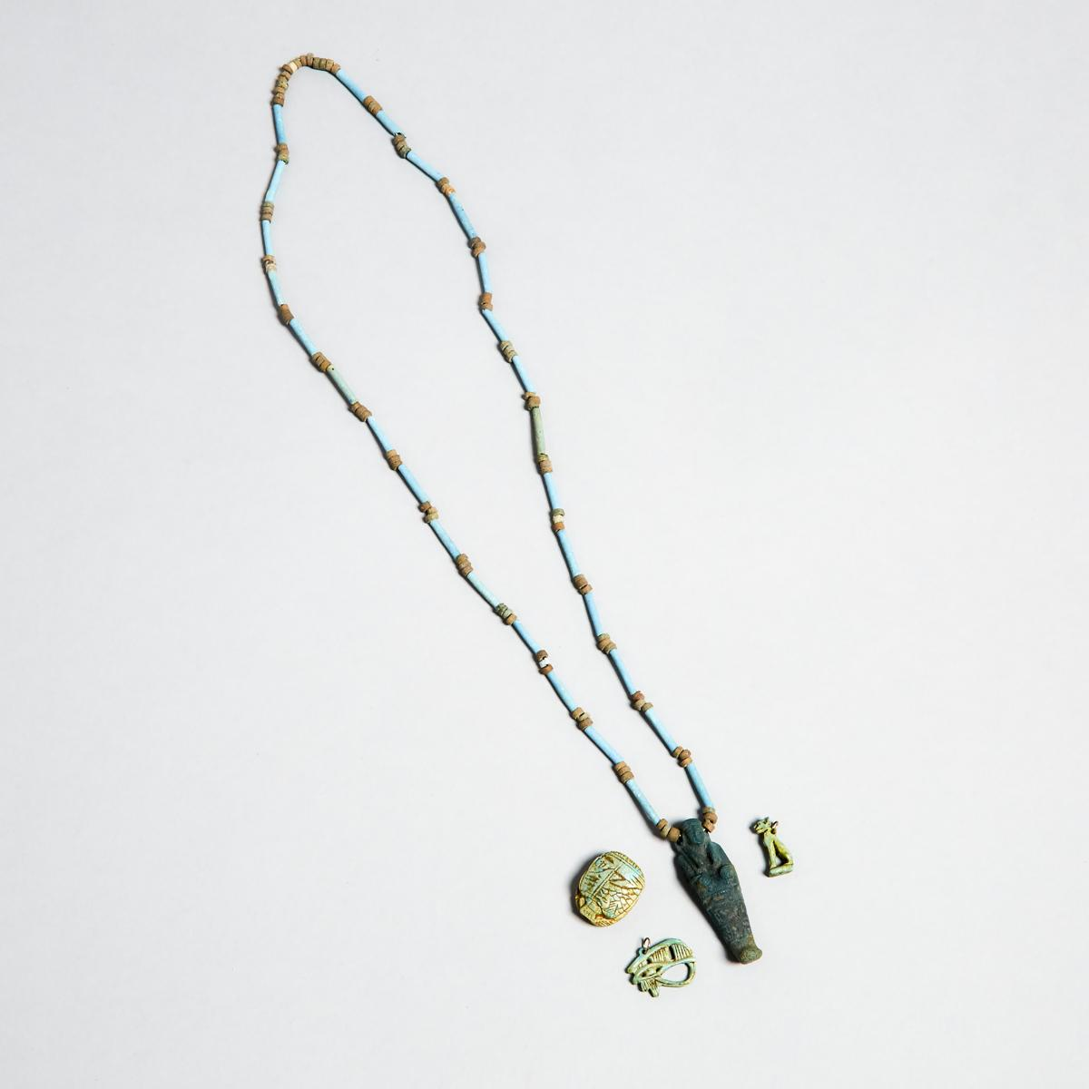 Group of Egyptian Turquoise Faience Amulets and Beads, New Kingdom to Late Period, 1550-332 B.C., sh