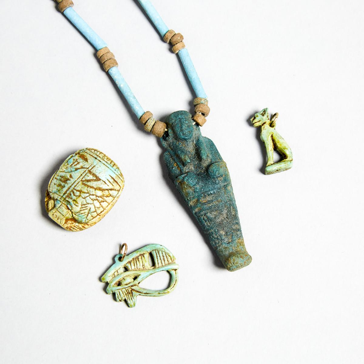 Group of Egyptian Turquoise Faience Amulets and Beads, New Kingdom to Late Period, 1550-332 B.C., sh - Image 2 of 3