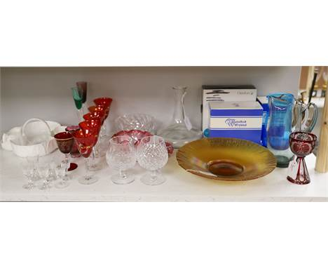 A quantity of glassware, including two Orrefors bowls (one boxed), a large iridescent centrepiece bowl, Waterford Crystal, in