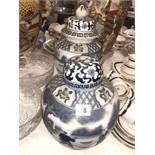 Two blue and white lidded vases