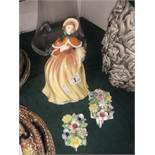 A Royal Doulton figurine and two Doulton posies