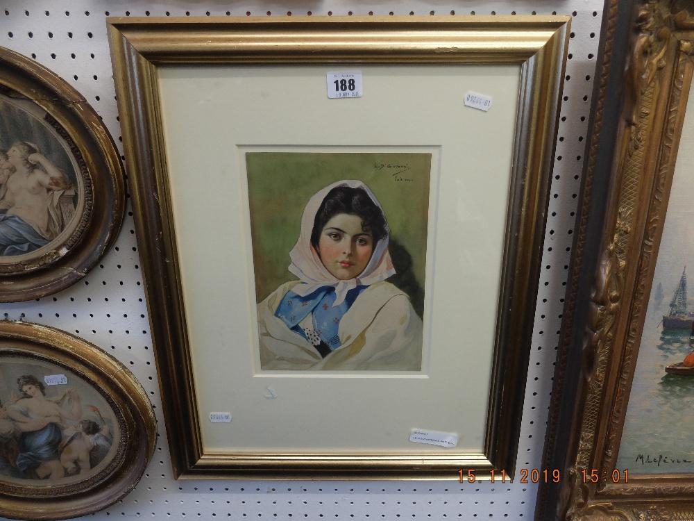 A gilt framed watercolour portrait signed L.