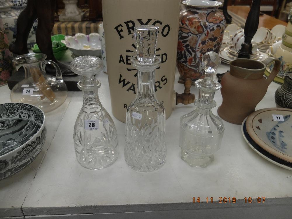 Three cut glass decanters