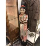 A carved wood oriental lady