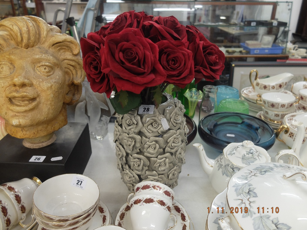 Lot 18 - Grey vase and roses