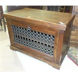 A hardwood television/hi-fi cabinet with drop-down pierced metal door, 89cm wide, 59cm high.