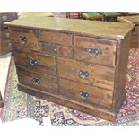 A Laura Ashley hardwood eight-drawer chest on plinth base, 126cm wide, 43cm deep, 85cm high.