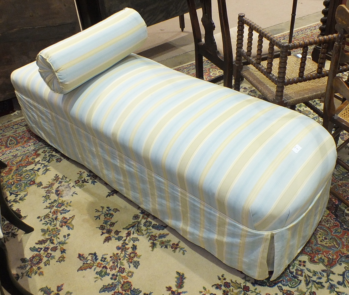 Lot 5 - A Victorian rectangular upholstered day bed on mahogany turned legs, 170 x 56cm.