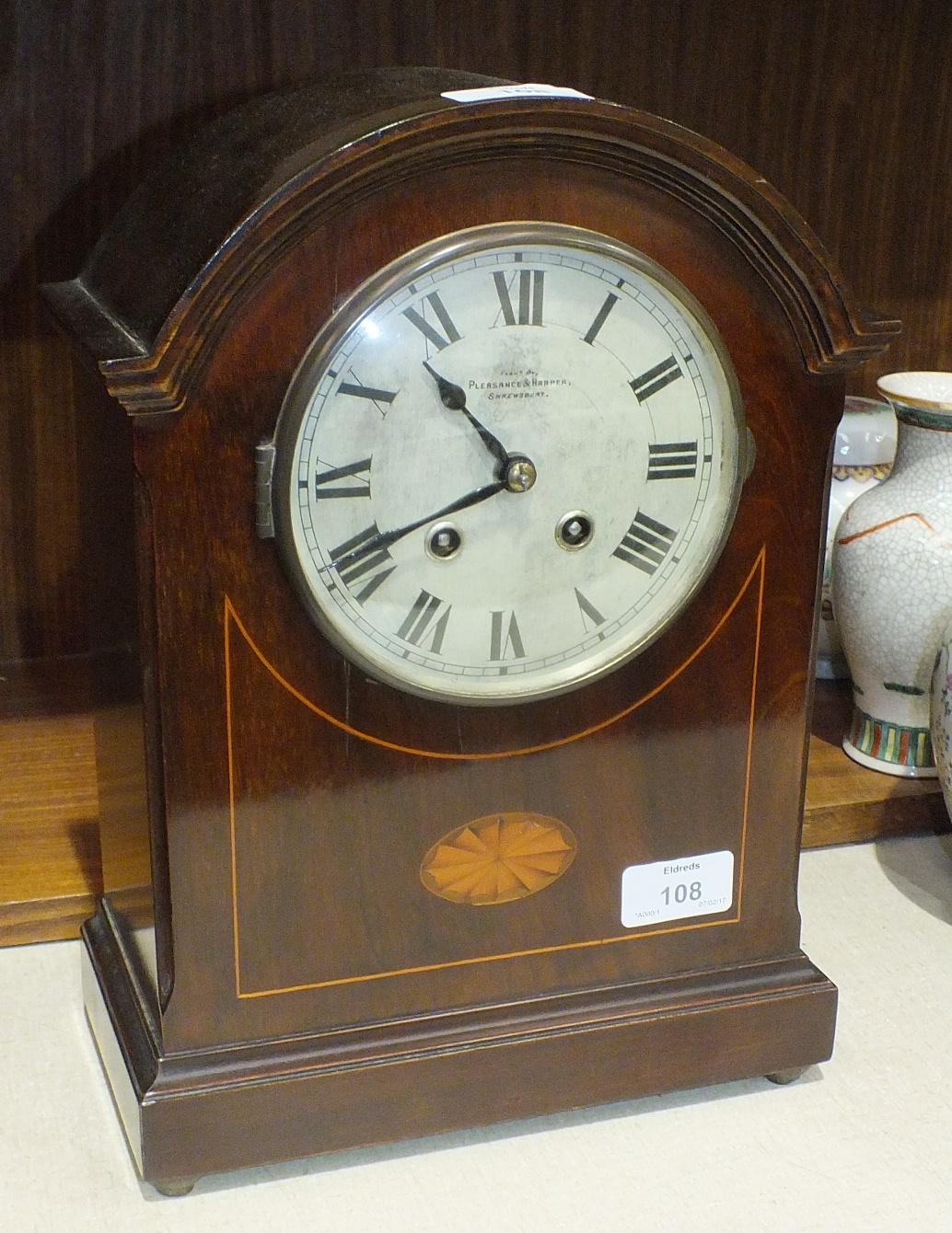 Lot 108 - An Edwardian dome-top mahogany striking mantel clock by the Hamburg American Clock Co, 32cm high,