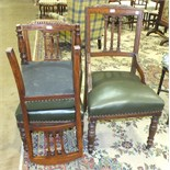 An Edwardian oak desk chair with upholstered seat, on turned front legs and a pair of matching