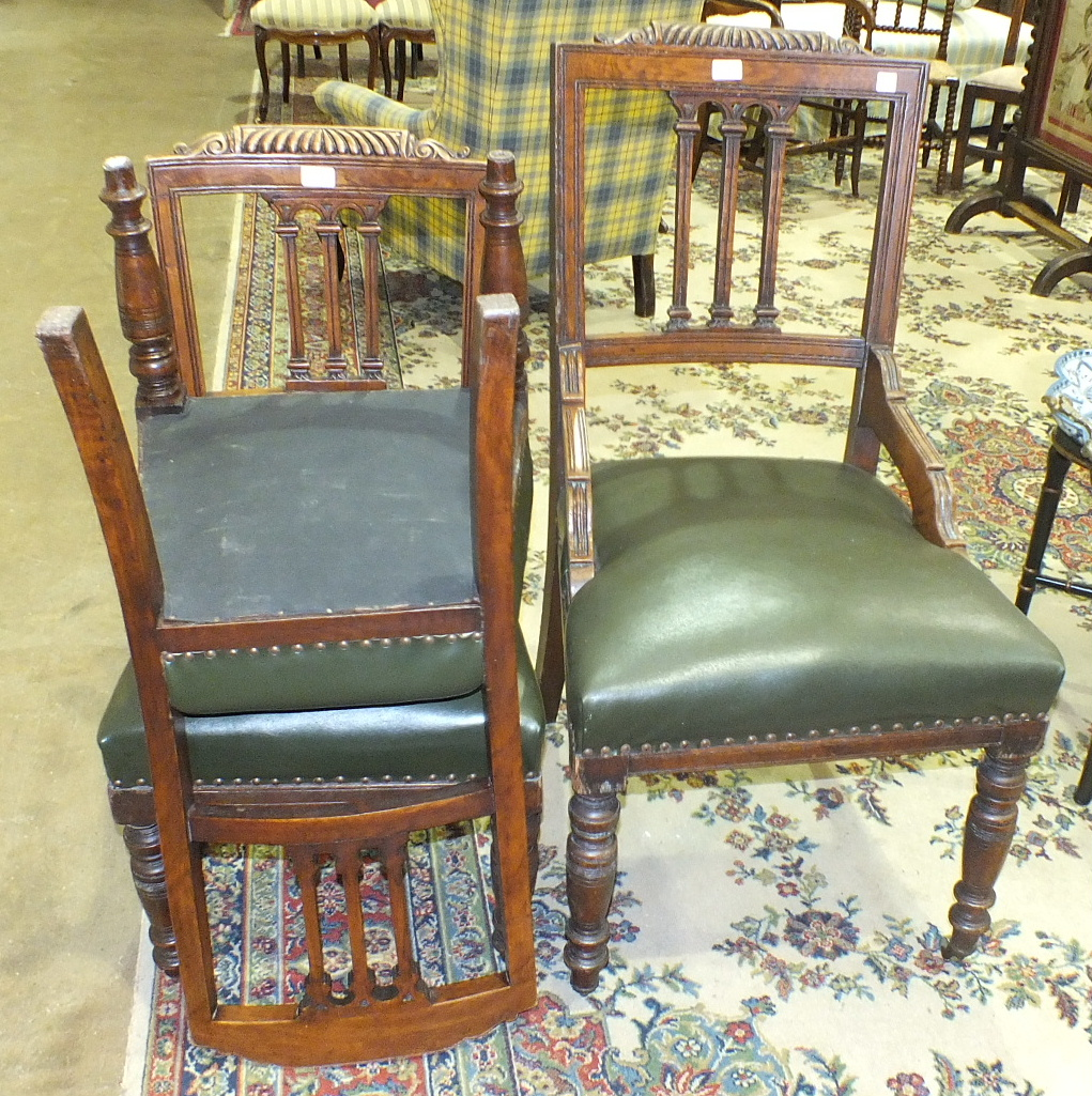 Lot 33 - An Edwardian oak desk chair with upholstered seat, on turned front legs and a pair of matching