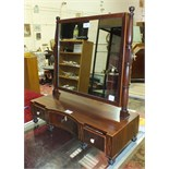 A 19th century mahogany toilet mirror, the rectangular mirror plate above a rectangular base, with