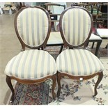 A pair of Victorian rosewood salon dining chairs with upholstered seat and back, on cabriole front