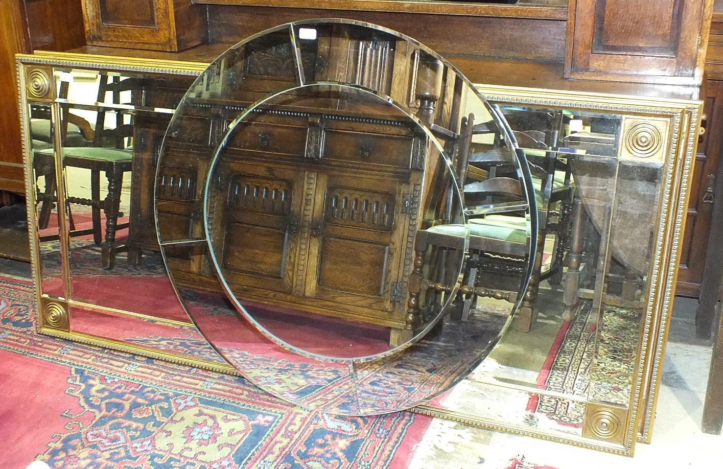 Lot 17 - A pair of modern gilt-framed bevelled rectangular wall mirrors, 177 x 86cm and a circular mirror, (