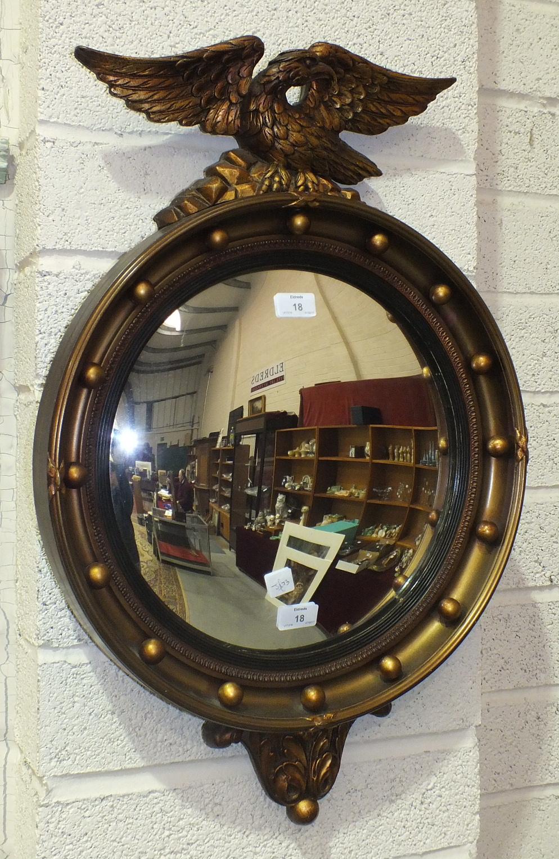 Lot 18 - A reproduction Regency gilt-framed convex mirror, 70 x 46cm.