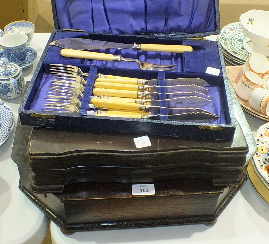 Lot 182 - A canteen of plated cutlery contained in an oak fitted box, other cutlery, an inlaid walnut