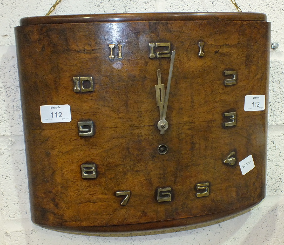 Lot 112 - An Art-Deco-style walnut wall timepiece of rectangular convex form, 28cm high, 33.5cm wide.