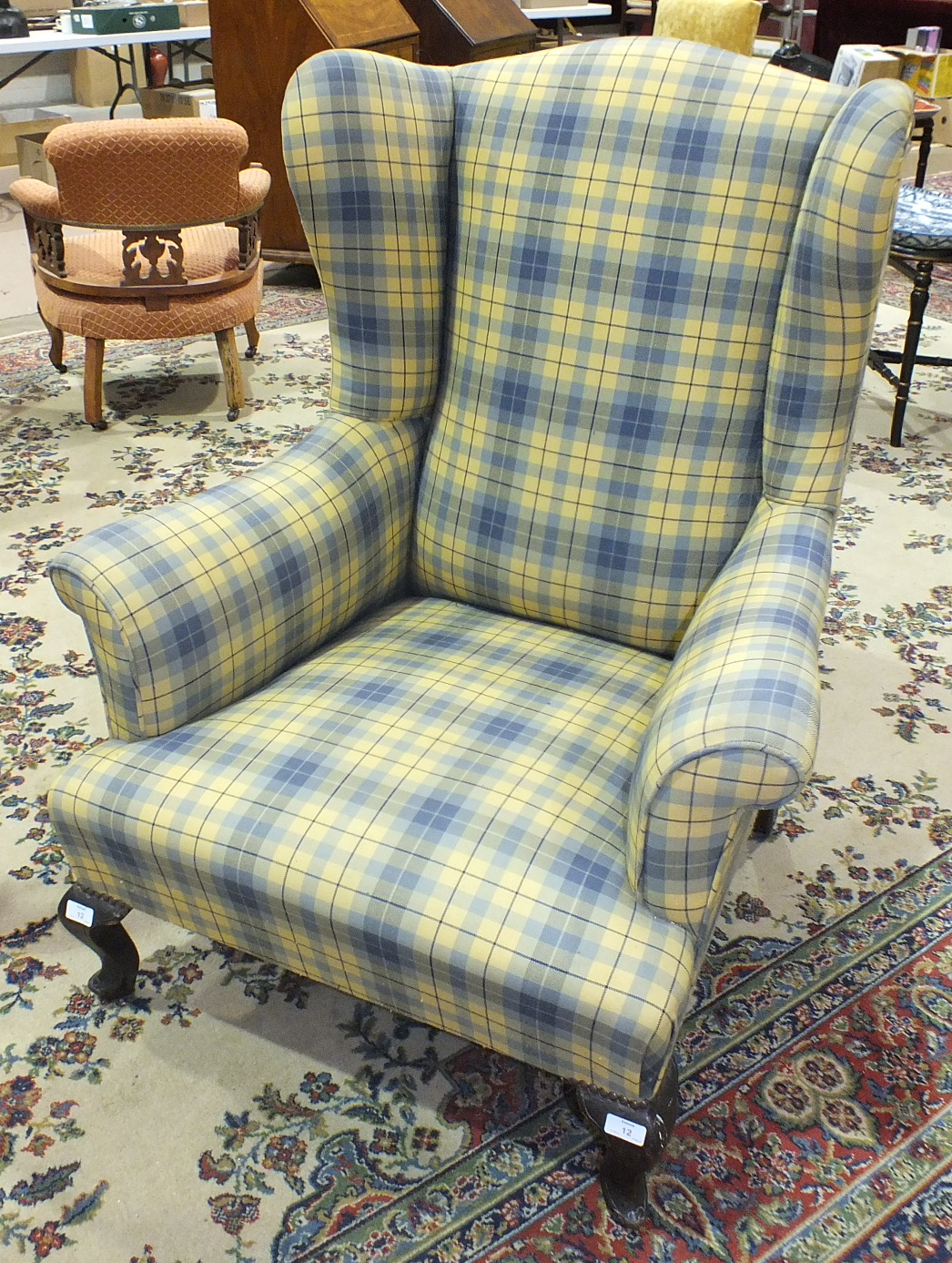Lot 12 - A late-19th century upholstered wing-back armchair on cabriole front legs, (re-covered).