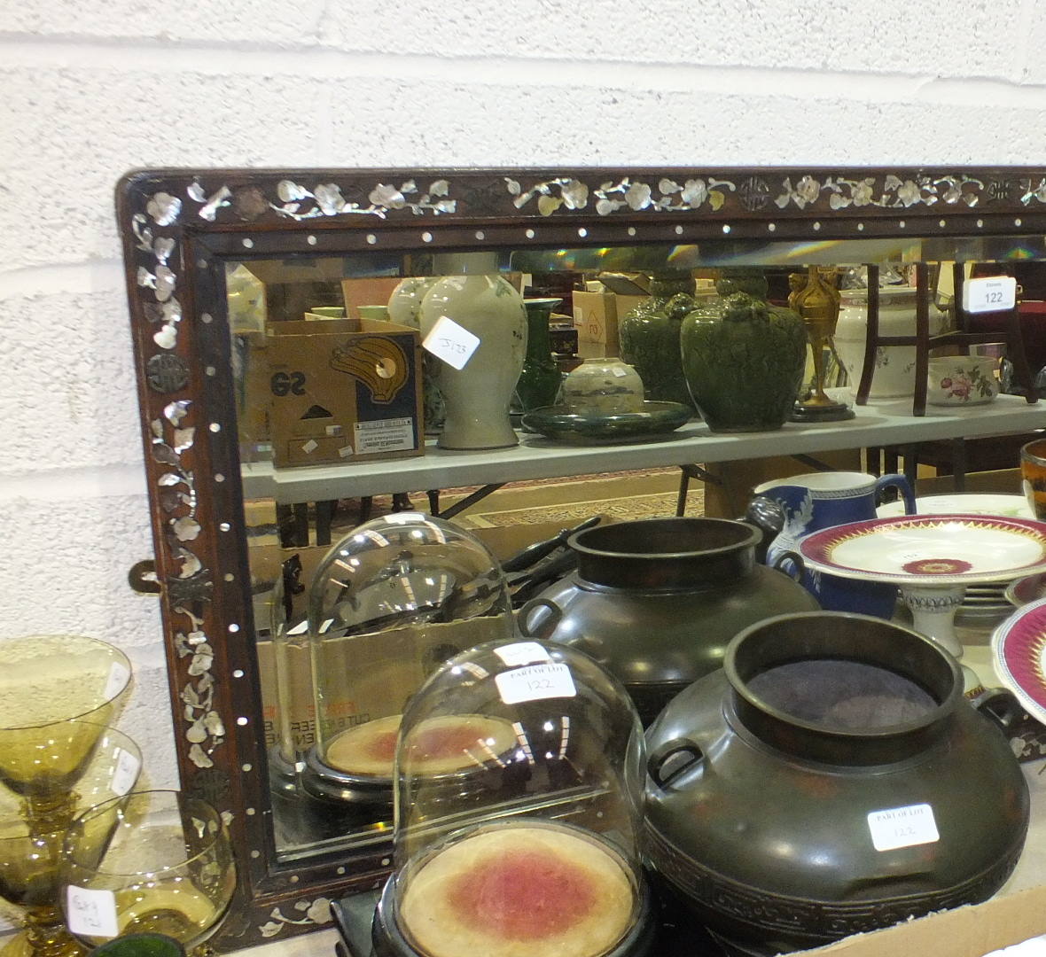 Lot 122 - An Oriental hardwood-framed mirror with mother-of-pearl inlay, 45 x 120cm, two black-lacquered