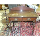 An Edwardian stained wood rectangular hall table fitted with two frieze drawers, on turned legs,