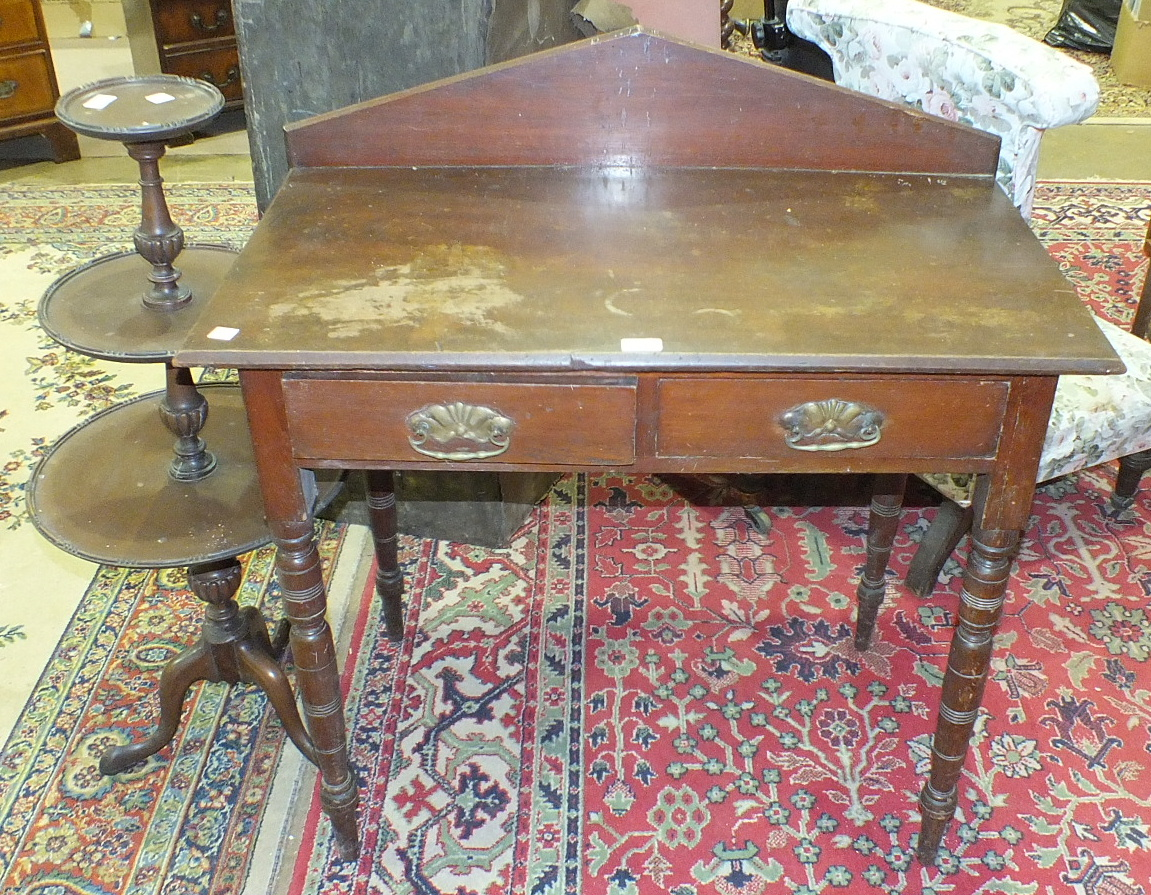Lot 28 - An Edwardian stained wood rectangular hall table fitted with two frieze drawers, on turned legs,