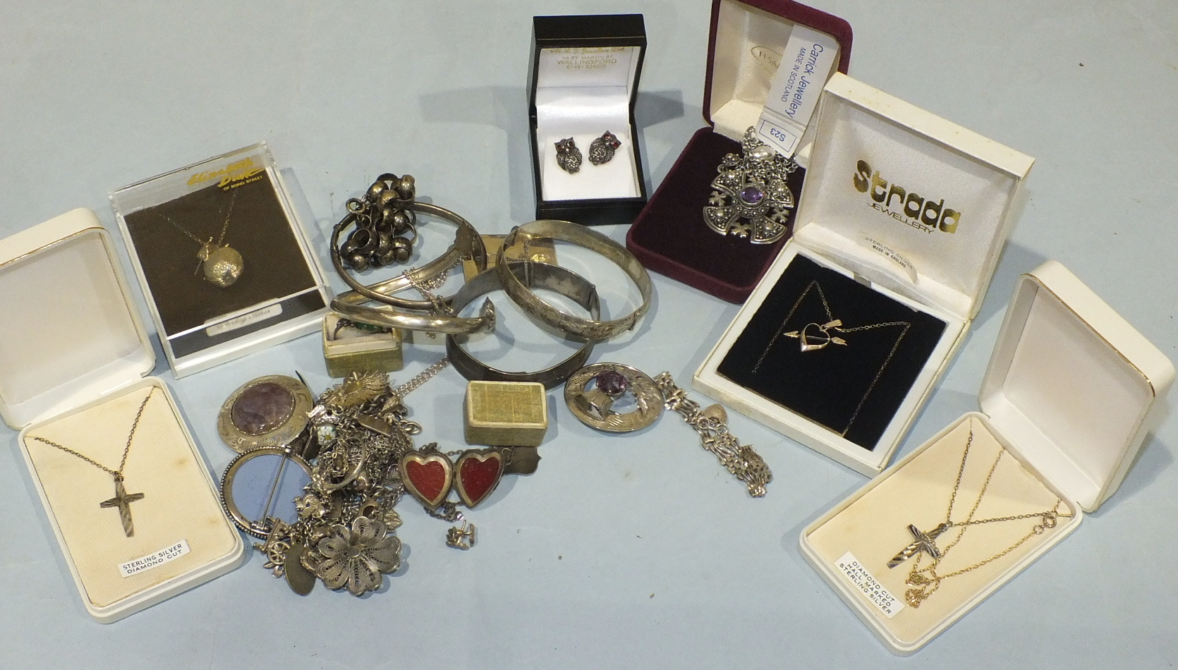 Lot 218 - A quantity of silver and white metal jewellery, including a pair of marcasite and garnet owl