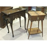 A walnut fold-over card table in the 18th century style with rectangular top, on shaped frieze and