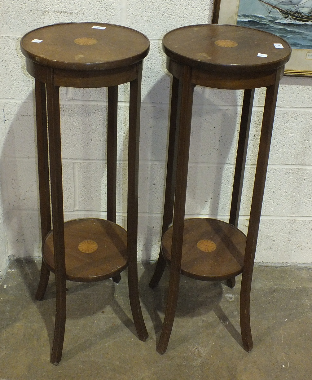 Lot 24 - A pair of Edwardian inlaid mahogany circular two-tier jardinières on shaped supports, 34cm diameter,