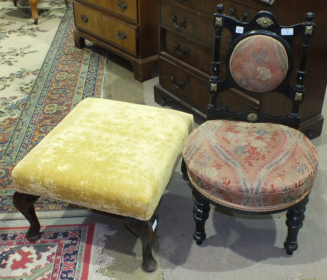 Lot 4 - An ebonised late-Victorian nursing chair with padded back and upholstered seat, on turned front legs