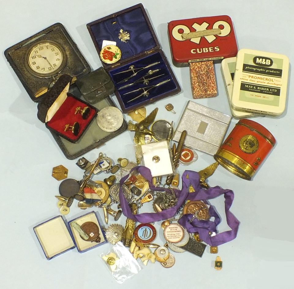 Lot 223 - A metal George VI souvenir Six Oxo Cubes money box, an 8-day travelling clock, various badges and