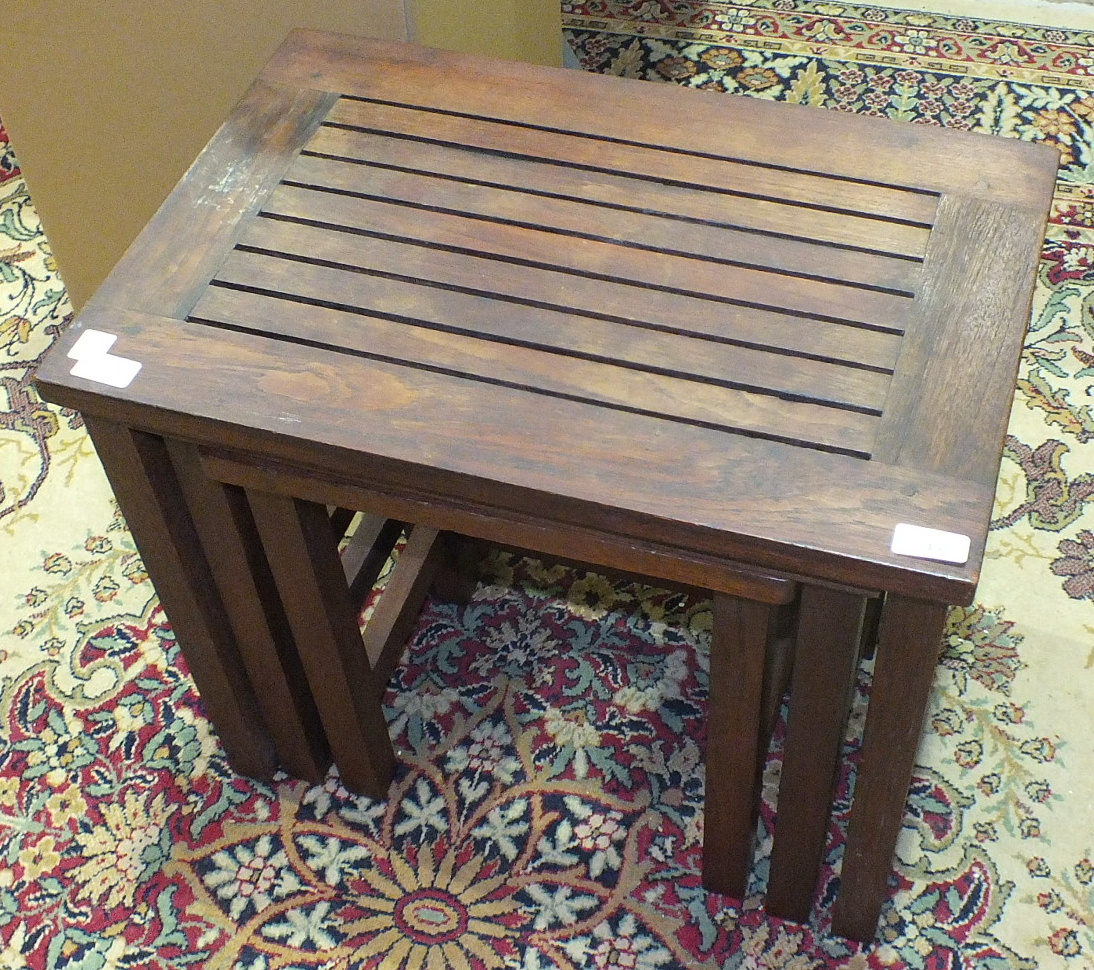 Lot 43 - A teak nest of three tables with plaque 'Made from Teakwood taken from the RMS Mauritania by the