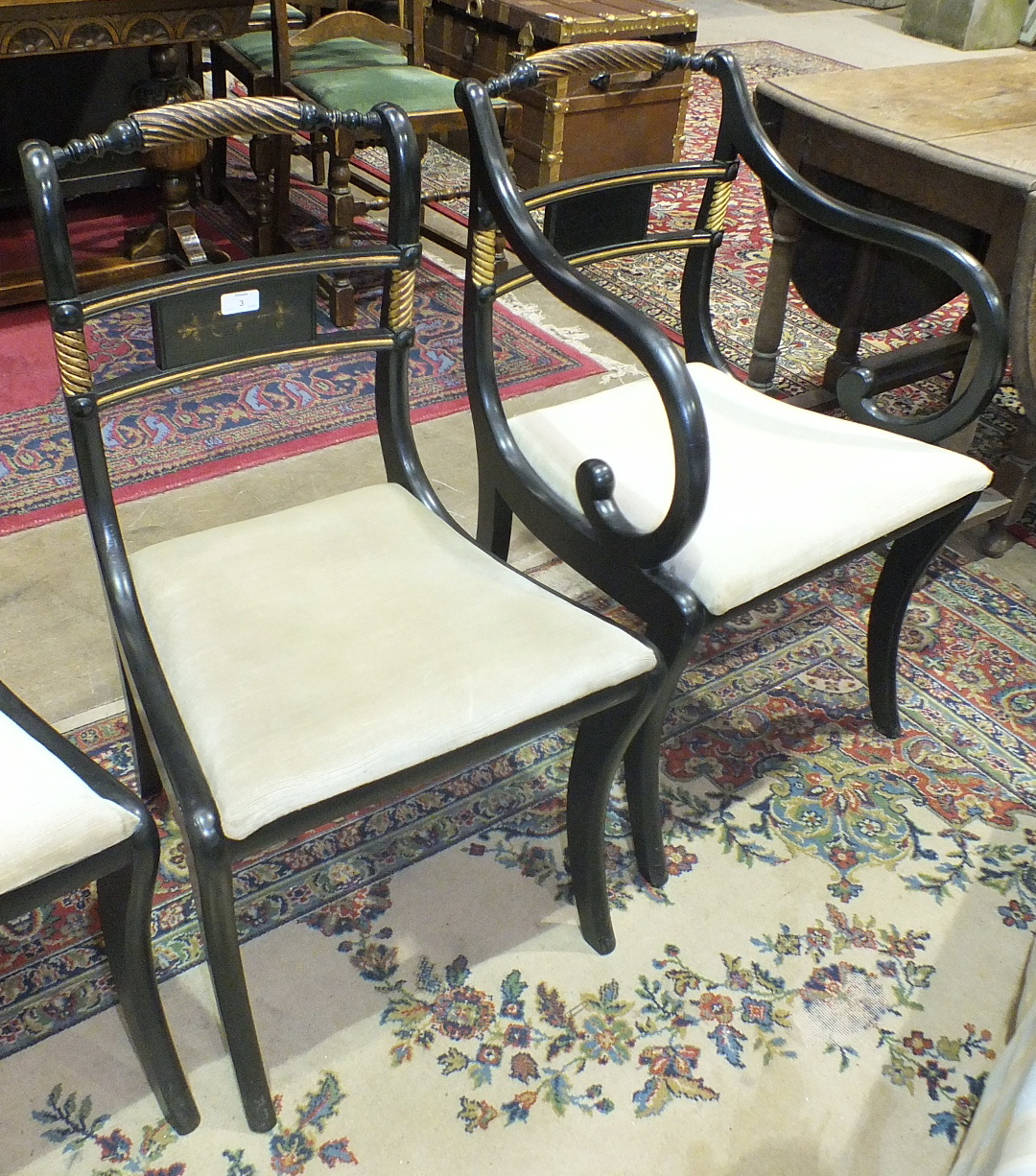 Lot 3 - A set of six Georgian-style ebonised wood bar and rope-twist-back dining chairs with drop-in