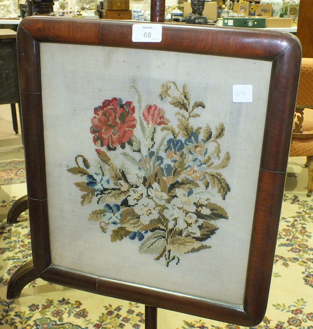 Lot 60 - A late-19th century mahogany pole screen raised on tripod base, with wool work floral panel, 148cm