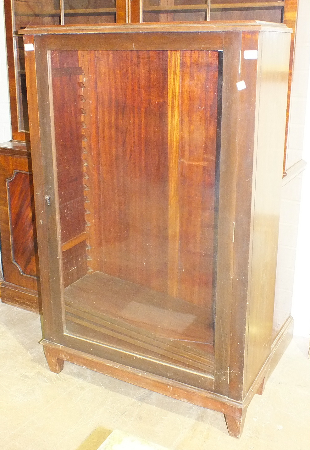 Lot 27 - A late-19th century mahogany bookcase top fitted with a glazed door and adjustable shelves, on later