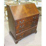 A reproduction mahogany Georgian-style bureau, the fall-front above four graduated long drawers,