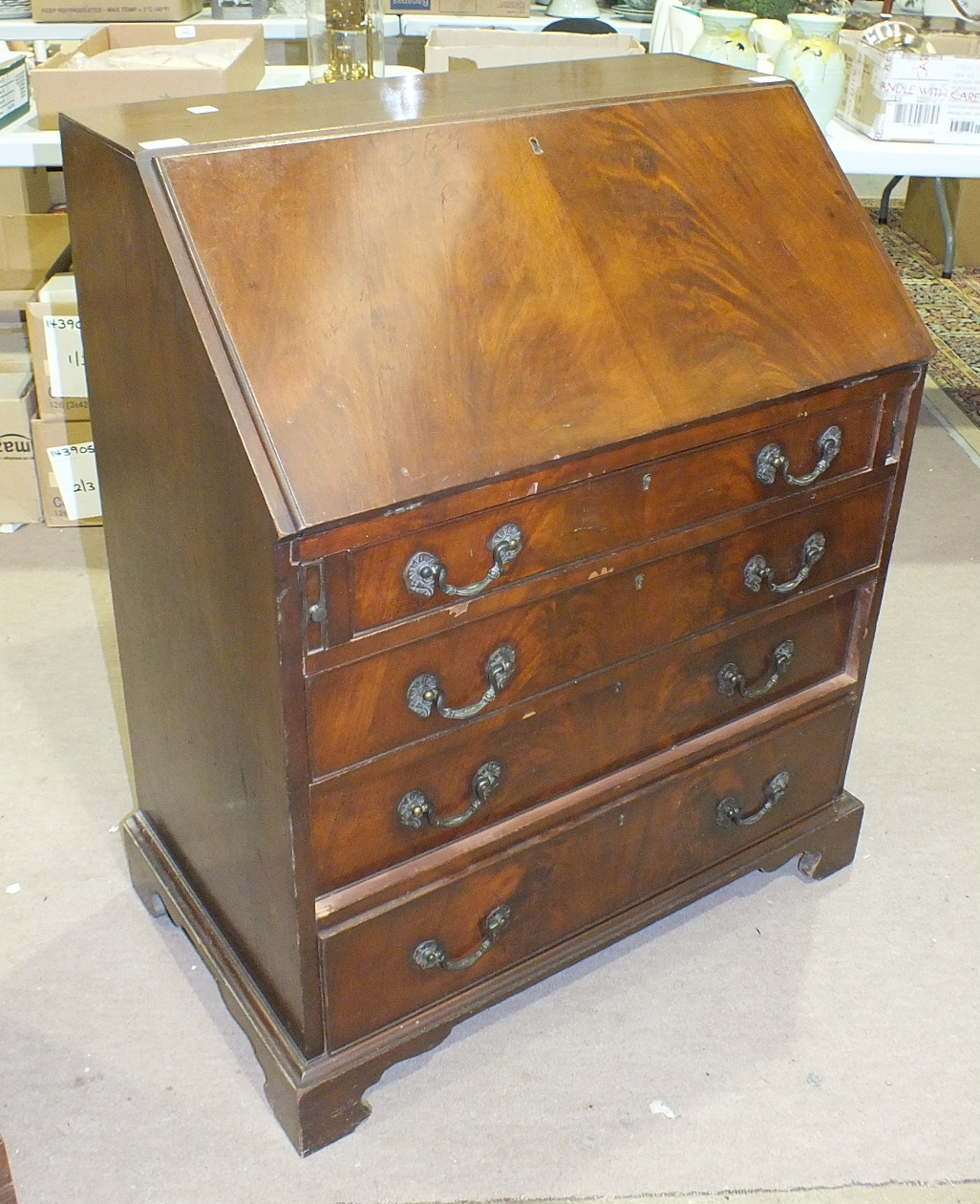 Lot 30 - A reproduction mahogany Georgian-style bureau, the fall-front above four graduated long drawers,