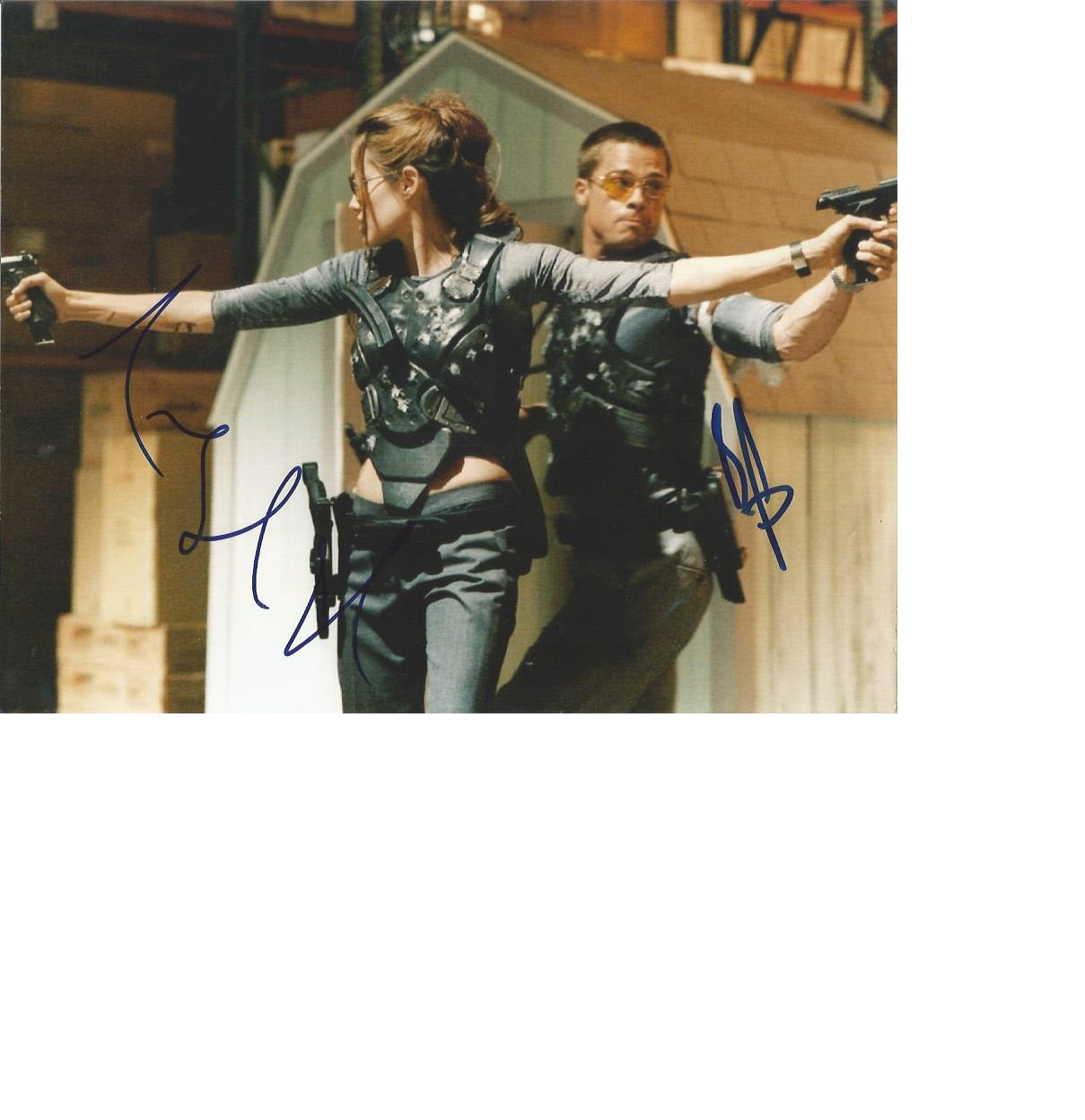 Lot 31 - Angelina Jolie and Brad Pitt signed stunning 10 x 8 colour action photo. Good Condition. All