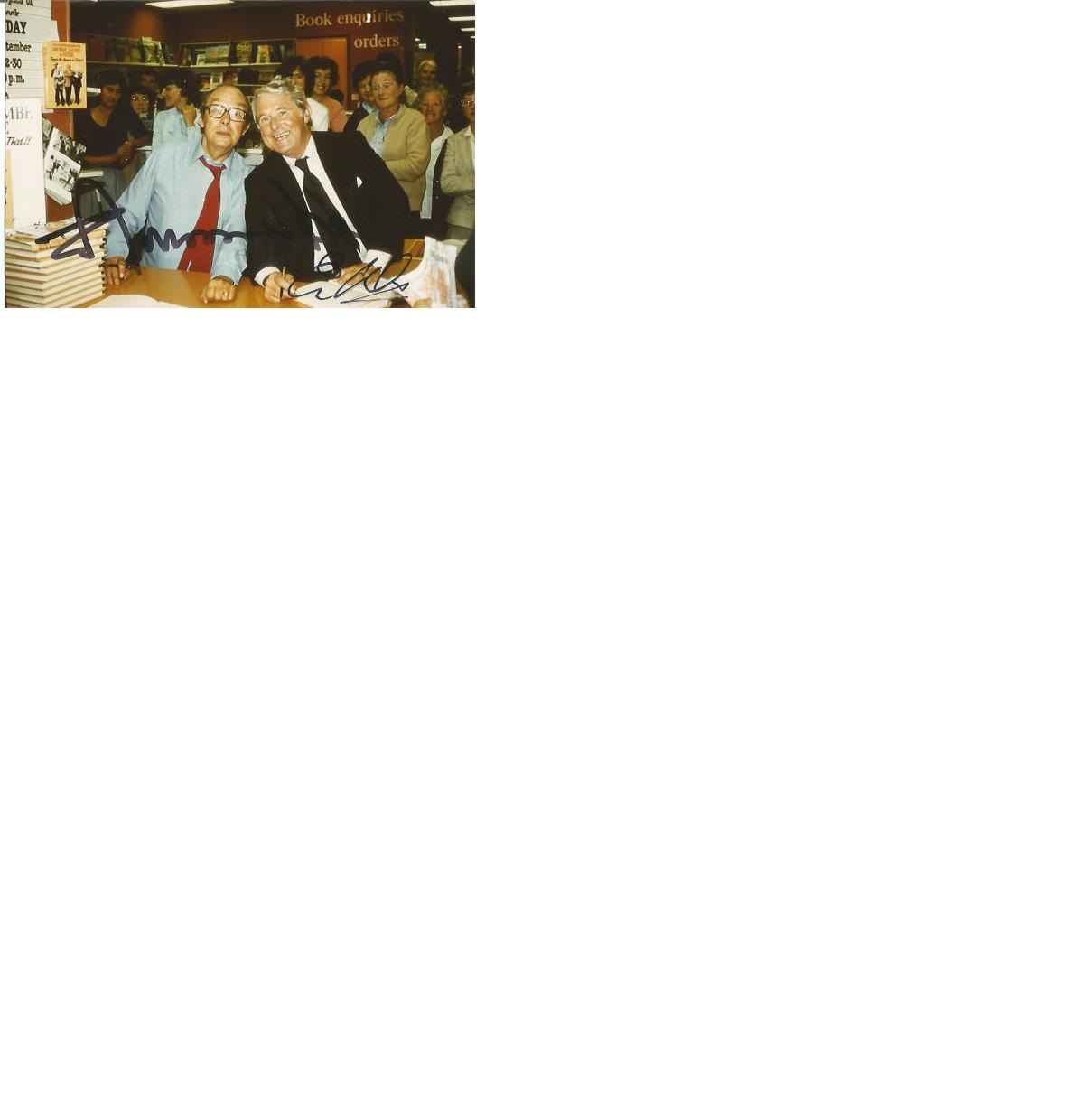 Lot 33 - Eric Morecambe and Ernie Wise signed 6 x 4 colour photo at a book signing. Good Condition. All