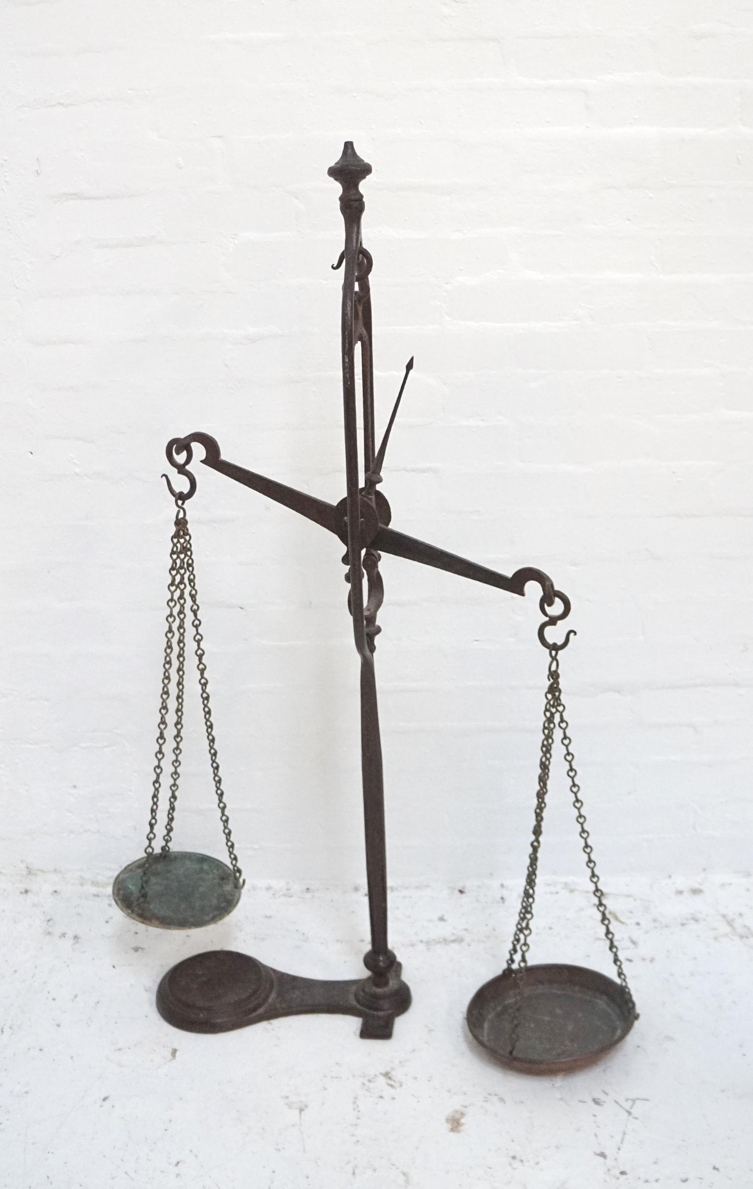 Lot 254 - SET OF VICTORIAN CAST IRON SHOP SCALES the central balance arm with two chain link weighing bowls,