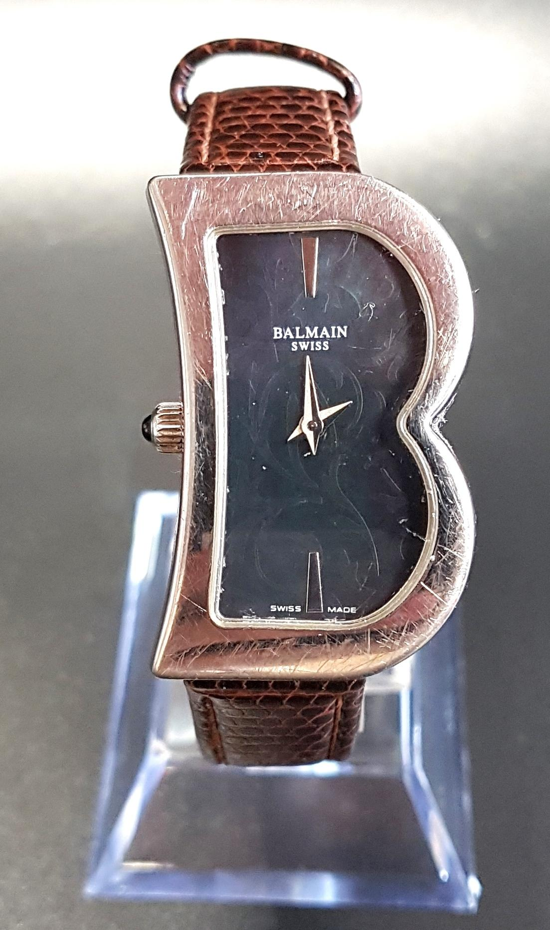 Lot 86 - LADIES PIERRE BALMAIN WRISTWATCH the black B shaped dial with scroll detail and baton markers at 6