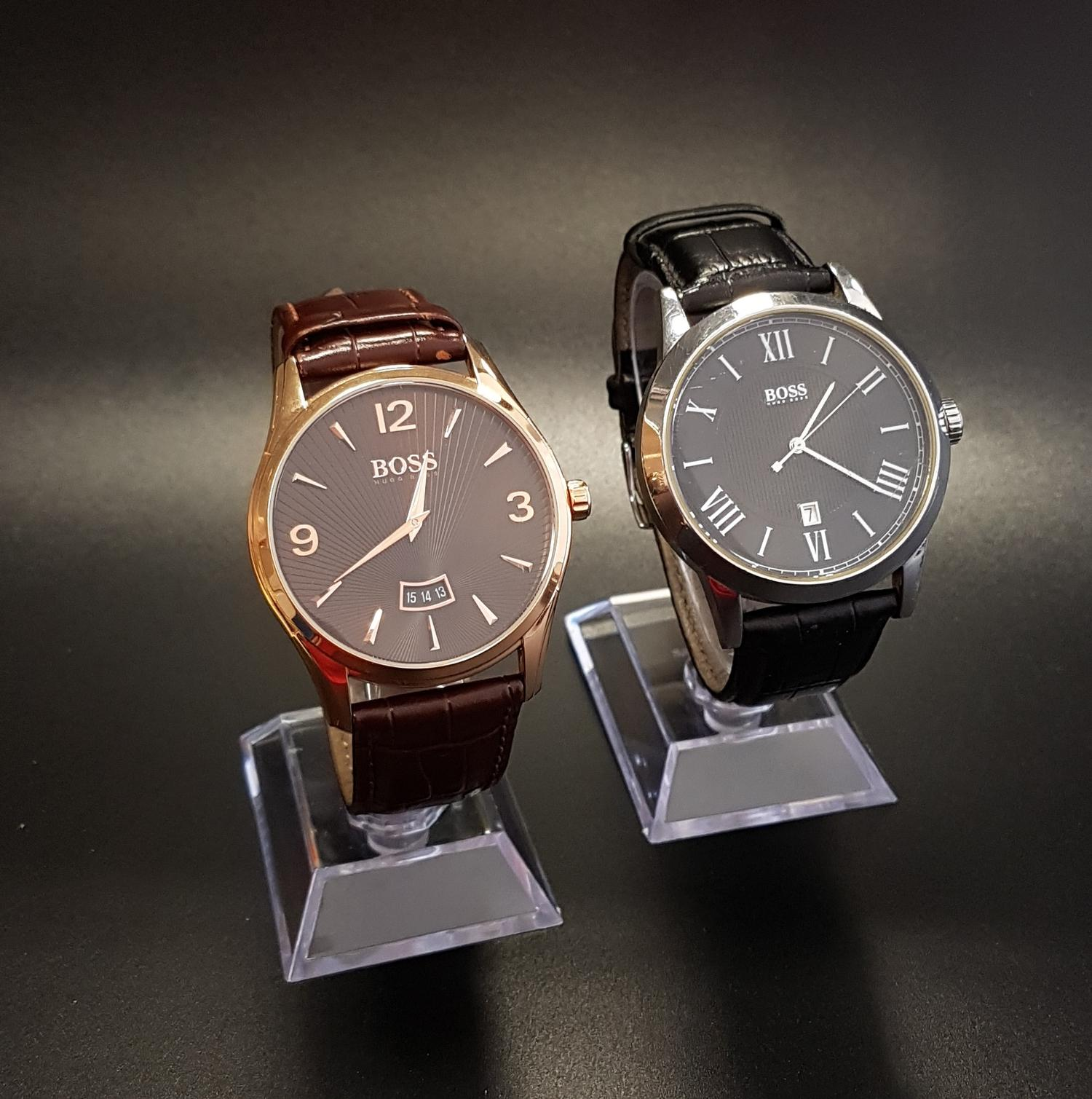 Lot 114 - TWO GENTLEMEN'S HUGO BOSS WRISTWATCHES one with brown leather strap and numbered HB.288.1.34.2931,
