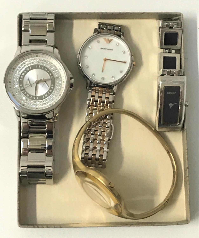 Lot 132 - FOUR LADIES DESIGNER WRISTWATCHES comprising Emporio Armani, DKNY, Calvin Klein and Armani